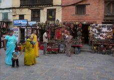 Kathmandu Nepal. Visitors of the Swayambhunath stupa stand about near gift shops - Kathmandu, Nepal during my visit royalty free stock images
