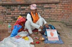 Kathmandu, Nepali, September, 30, 2013. Man foretelling the fate of the hand on the street Stock Photo