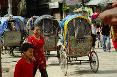 KATHMANDU,NP CIRCA AUGUST 2012 - Rickshaws, typical transportati royalty free stock photography