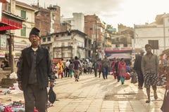 People walking at Durbar Square in Kathmandu. KATHMANDU - OCTOBER 05: People walking at Durbar Square in Kathmandu, Nepal, October 05, 2017 Stock Photo