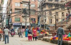 People walking at Durbar Square in Kathmandu. KATHMANDU - OCTOBER 05: People walking at Durbar Square in Kathmandu, Nepal, October 05, 2017 Royalty Free Stock Photo