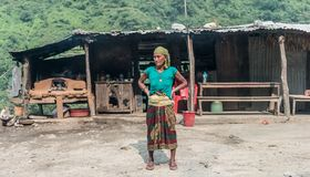 Nepalese woman standing in front of hut Stock Image
