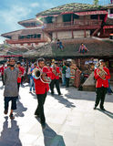 Kathmandu street life. Musiciants playing at relogious ceremony. Nepal, Kathmandu Stock Photos