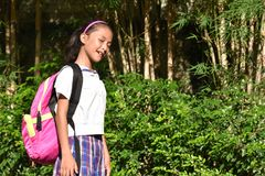 Katholiek Filipina Girl Student Winking stock foto
