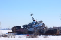 Kathryn Spirit abandoned ship. BEAUHARNOIS, Quebec, Canada, March 19th, 2017. Kathryn Spirit abandoned ship still waiting to be dismantled and menacing to Royalty Free Stock Photography