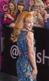 Kathy Griffin. Comedian Kathy Griffin interacts with fans as well as the media as she arrives on the red carpet for the New York premiere of Season 4 of HBO Royalty Free Stock Photos