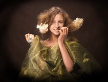 Katja. Young lady with a smile and flowers in hair Royalty Free Stock Image