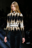 Katja Ledneva walks the runway during the Balmain show Stock Images