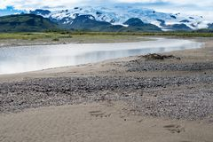 Free Katmai National Park With River, Beach, Sand And Mountains With Glaciers. Sunny Summer Day In Alaska. Bear Footprints In The Sand Stock Photography - 131682672