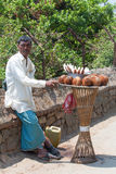 KATMANDU, NEPAL -  APRIL 18 2013: Seller coconuts in traditional Royalty Free Stock Photography