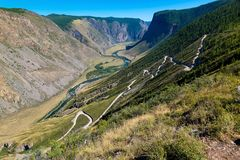 Kato-Yaryk Pass, long descent to the valley of the Chulyshman River, Altai Republic, Russia stock photography