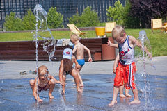 KATOWICE, POLAND - JULY 19, 2015: Children playing in the founta. In on 19 July 2015 in Katowice, Poland. On hot days, children play in the fountain in the city Royalty Free Stock Images
