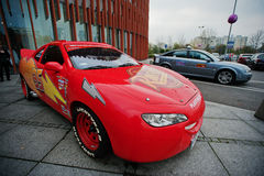 Katowice, Poland - October 24, 2014: Lightning McQueen a larger. Version of the car, cartoon character of the Disney Pixar feature film Cars royalty free stock images