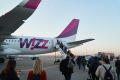 KATOWICE, POLAND - 11 10 2018: Wizz air airplane on an airport, people come inside. Wizz Air Airlines is an hungarian budget stock photography