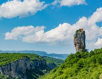 Katskhi Pillar outside Kutasi, Georgia. Katskhi Pillar is a single 120 foot tall towering pillar of rock with a small cell for a single monk at the top stock photography