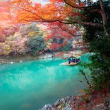 The Katsura river. Boatman punting the boat for tourists to enjoy the autumn view, The katsura river in the morning, Kyoto Japan Stock Image