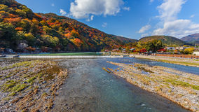 Katsuragawa river at Arashiyama in Kyoto. KYOTO, JAPAN - NOVEMBER 19: Oigawa River in Kyoto, Japan on November 19, 2013. Located in front of the Arashiyama Stock Photo