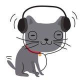 Katt i hörlurar som lyssnar till musik Arkivfoto