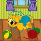 Katt som spelar med garnnystan i rum Arkivbilder