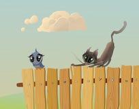 Katten jagar en fågel Royaltyfri Fotografi