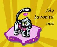 Katten på kudden Arkivbild