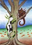 Katter i ett träd Arkivbilder