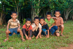Katu ethnic boys. LAO NGAM, SALAVAN, LAO P D R - DECEMBER 6 ; Unidentified katu ethnic boys are looking and smiling to camera in coffee farm at vangyawn village royalty free stock image