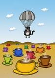 Katze landet mit einem Fallschirm stockfoto