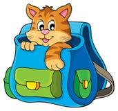 Katze in Schultaschenthemabild 1 Stockfotografie