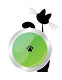 Katze und grüne Taste Stockbilder