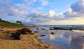 Kauai Beach Morning. The sky reflects brilliantly on the surf after the sunrise on the beach in Lihue, Kauai Stock Photography