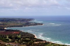 Kauai Coast. Aerial view of the shores of Kauai, a town in foreground and background, cloudy skies, on the horizon is the Pacific ocean Royalty Free Stock Photography