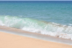 Kauai paradise beach. Breaking wave on white sand beach with turquoise water Stock Photos