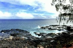 Kauai rocky shoreline. Blue skies over the rocky shoreline of Kauai Stock Image