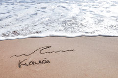 Kauai sand message. Kauai message in the sand beach with ocean sea water wave approach in Hawaii Stock Photo