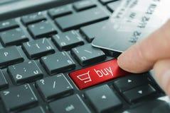 Kauf des roten Knopfes Stockfoto