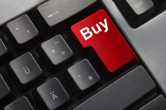 Kauf des roten Knopfes der Tastatur Stockbilder