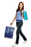 Kaufende glückliche junge Frau Stockfoto