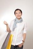Kaufendes asiatisches Mädchen Stockfotos