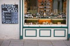 Kaufendes Gold für Bargeld Stockbilder