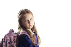 Kaukasisch elementair leeftijdsschoolmeisje met glazen Royalty-vrije Stock Afbeeldingen