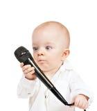 Kaukasische babyjongen met microfoon Stock Foto's