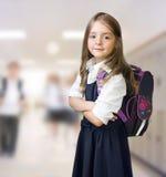Kaukasische het kind binnen achtergrond van het schoolmeisje stock afbeeldingen
