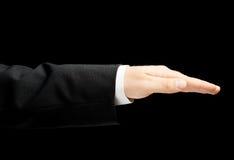 Kaukasische männliche Hand in einem Anzug lokalisiert Lizenzfreies Stockbild