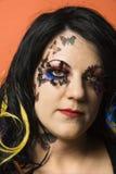 Kaukasische vrouw die unieke make-up draagt. Stock Afbeeldingen