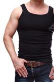 Kaukasischer männlicher Torso und Arme auf Jeans Stockfotografie