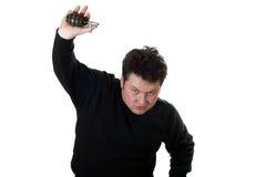 Kaukasischer Mann mit Handgranate. Stockfotos