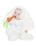 Kaukasisches Baby in einem Abendkleid des Kaninchens Stockfotos