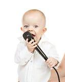 Kaukasisches Baby mit Mikrofon Lizenzfreies Stockfoto