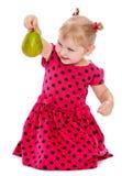 Kaukasisches blondes kleines Mädchen in einem roten Tupfen Stockfotografie